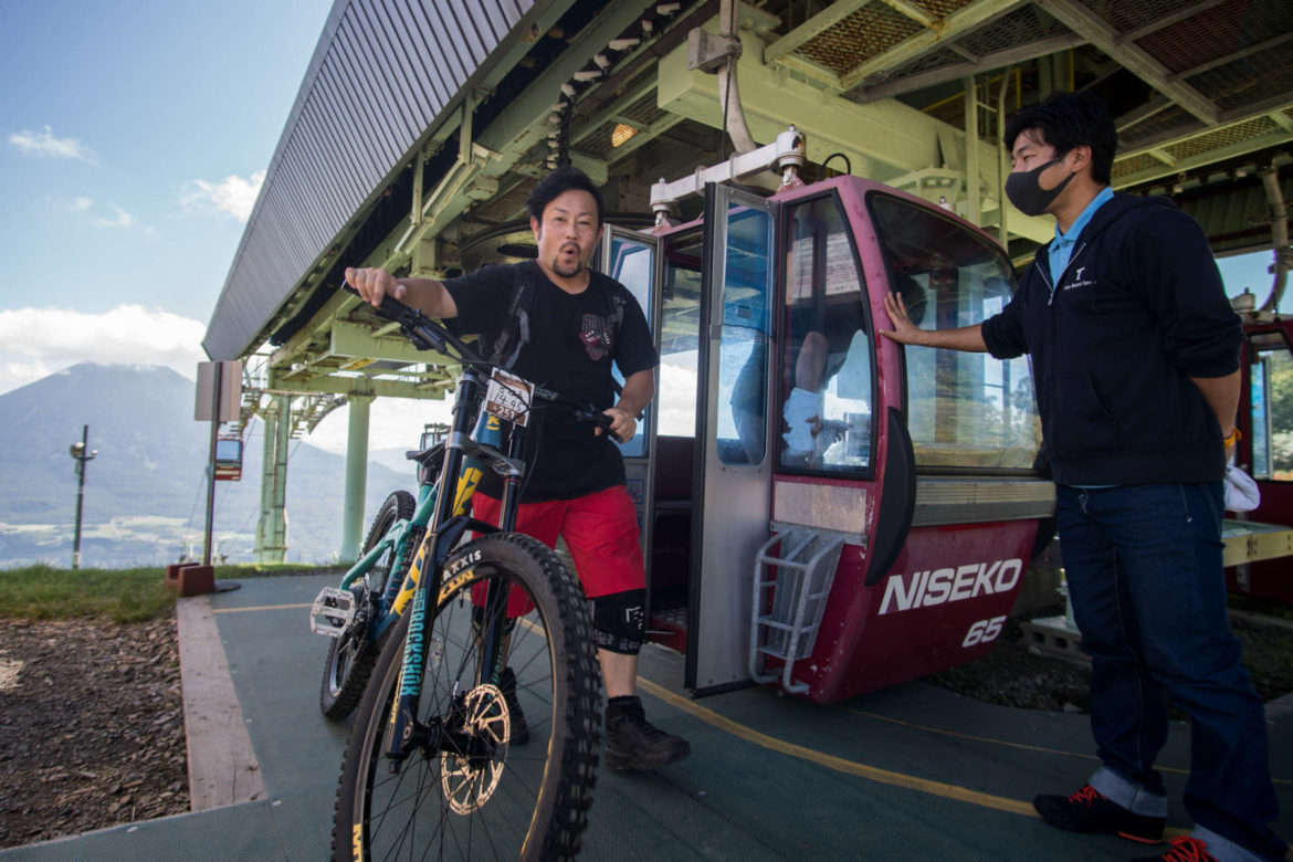 mountain biker dismounts summer gondola at grand hirafu niseko