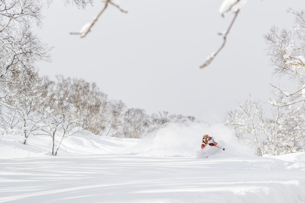 skier enjoying a deep powder run